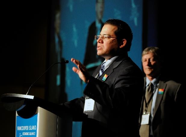 Pedro Marquez announcing VI 2065 at the 2013 Economic Summit (VIEA President, George Hanson in the background)