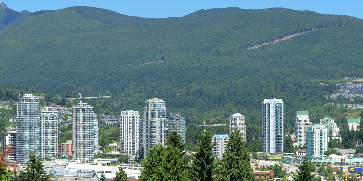 Skyscrapers in the Town Centre area of the city of Coquitlam, with the North Shore Mountains in the background. (photo credit: Greg Salter)