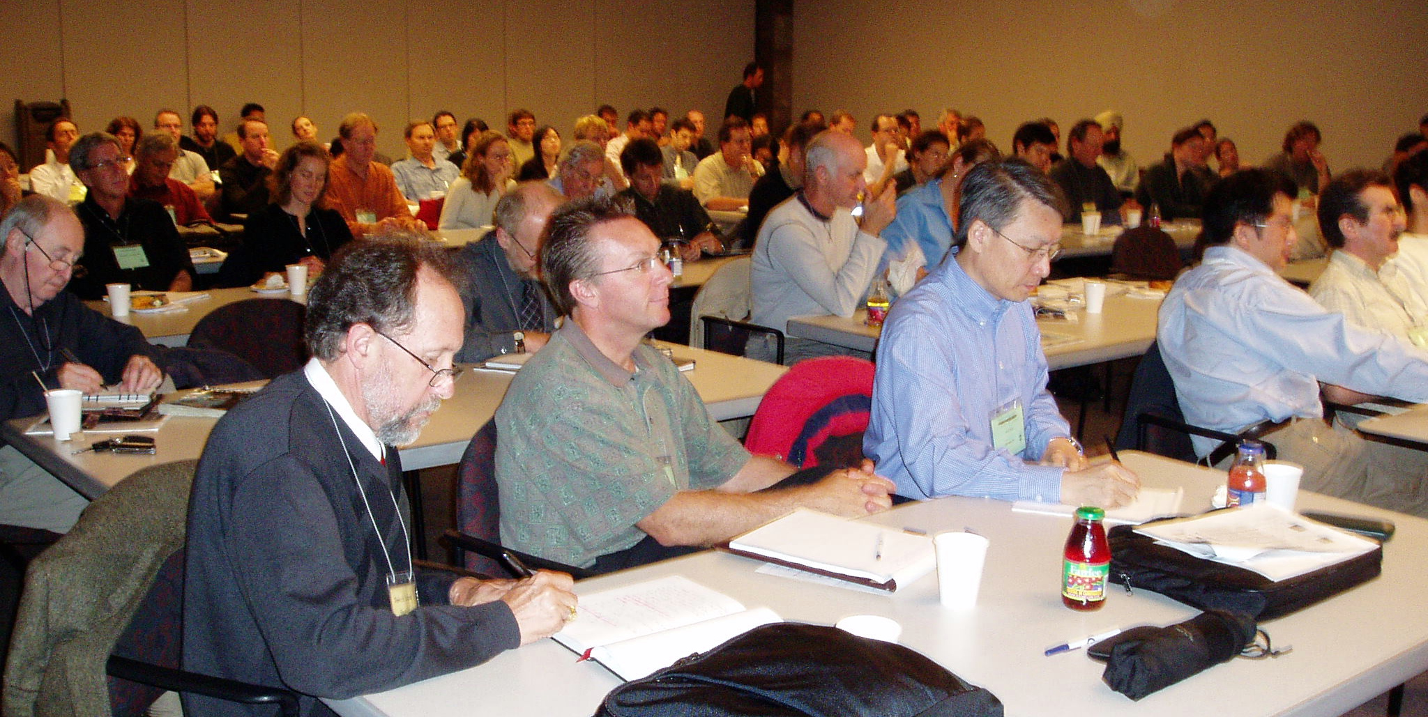 Patrick Lucey (L) in the audience at 2005 workshop headlined by  Peter Coombes