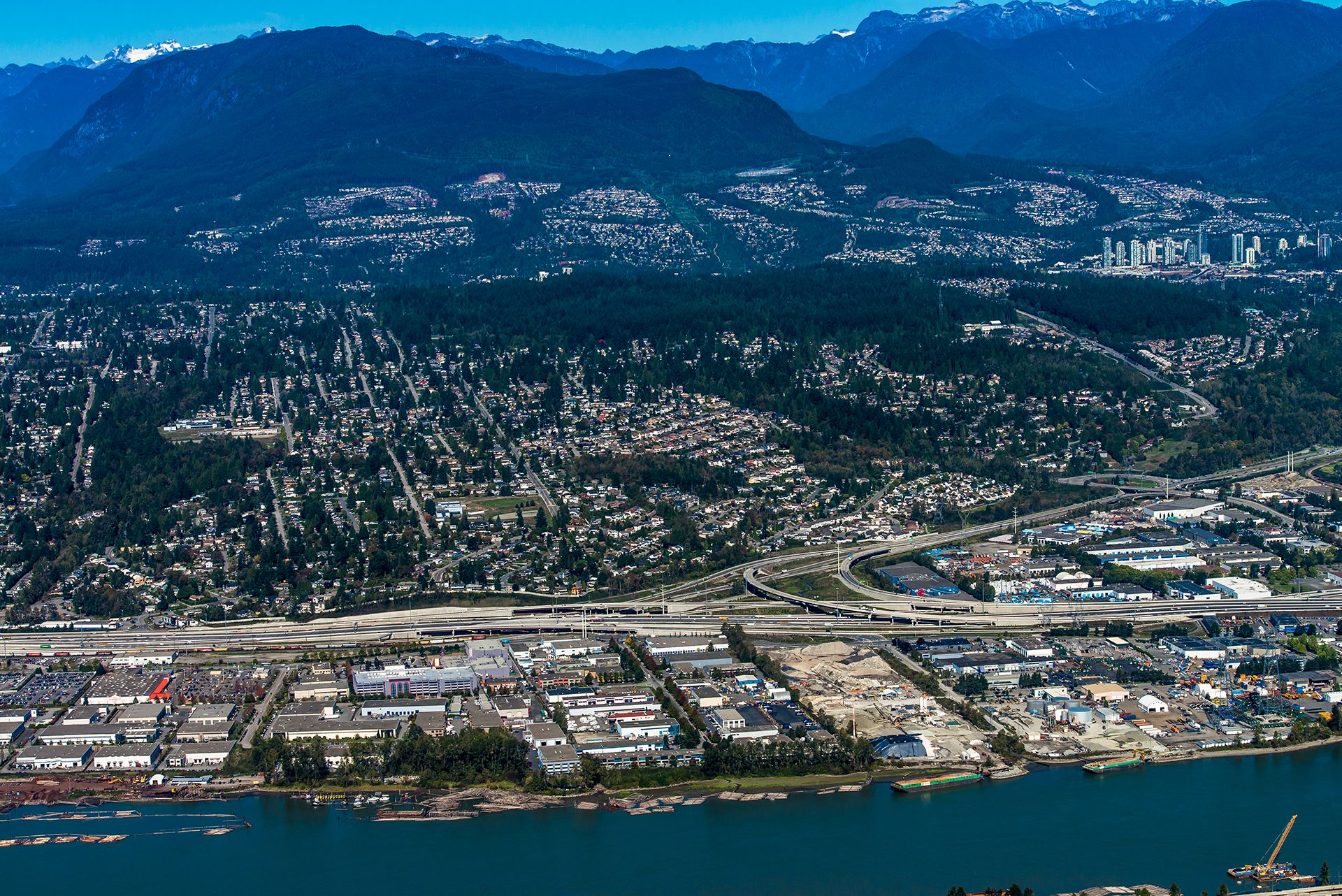 aerial view, looking north from the Fraser River, of the Coquitlam River watershed