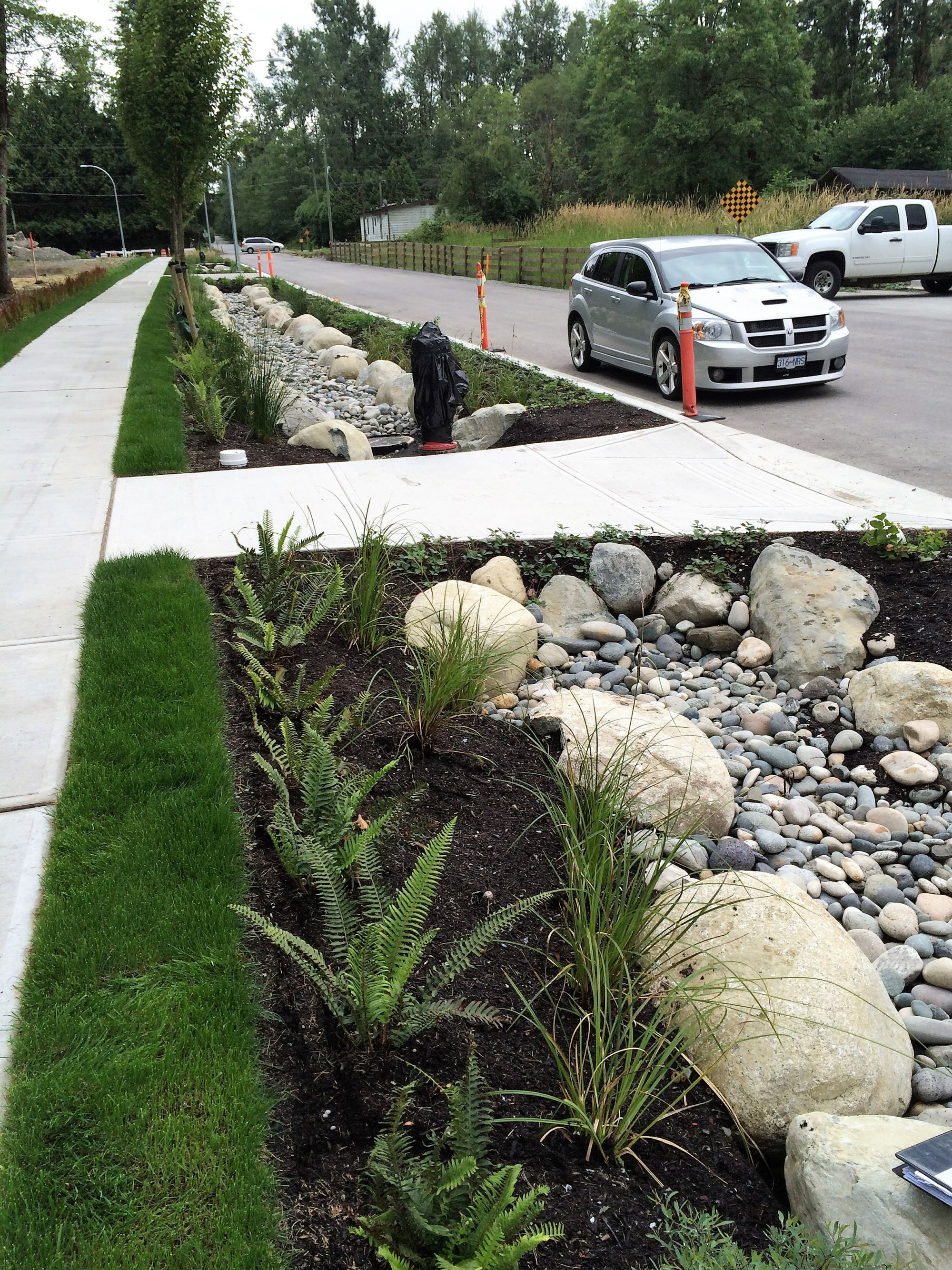 The 'blue link' is the new drainage standard in Langley. It replaces the traditional curb-and-gutter detail for all but arterial roadways.