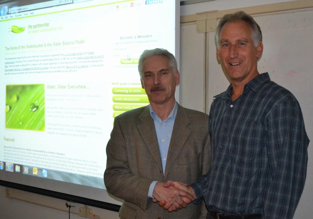 Tim Pringle hands off the Partnership Presidency to Ted van der Gulik, March 2014